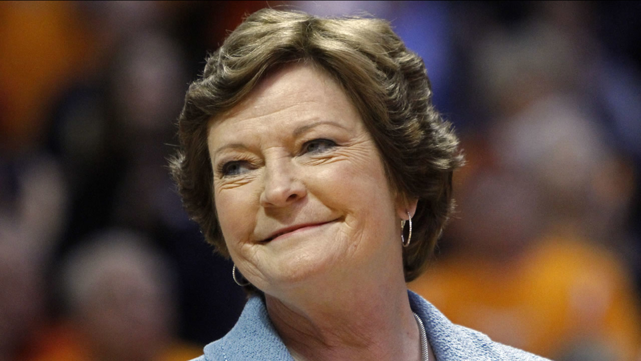 In this Jan. 28, 2013, file photo, former Tennessee women's basketball coach Pat Summitt smiles as a banner is raised in her honor.