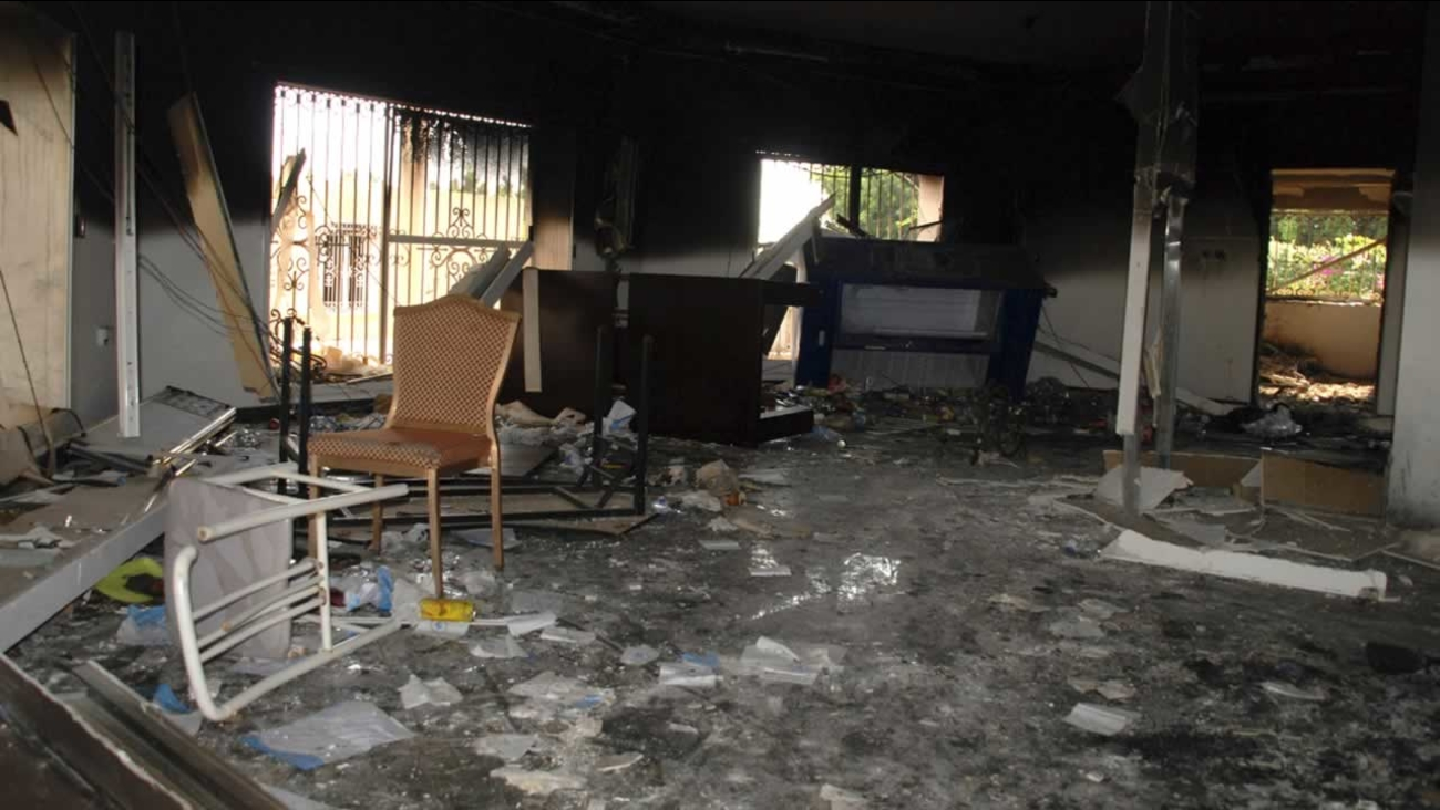In this Sept. 12, 2012 file photo, glass, debris and overturned furniture are strewn inside a room in the gutted U.S. consulate in Benghazi, Libya.