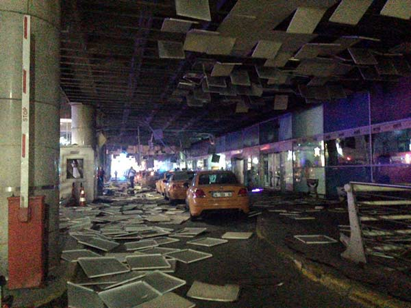<div class='meta'><div class='origin-logo' data-origin='AP'></div><span class='caption-text' data-credit='DHA via AP'>An entrance of the Ataturk Airport in Istanbul after explosions, Tuesday, June 28, 2016.</span></div>