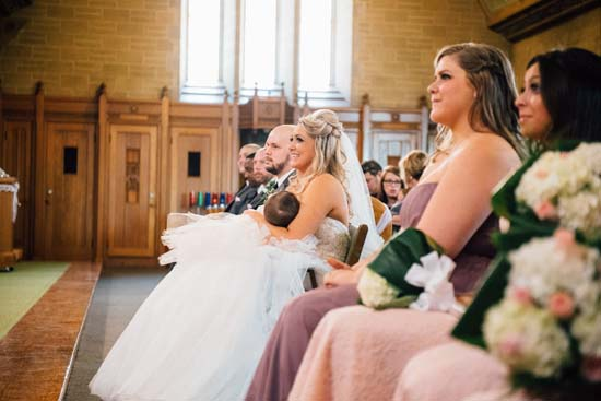 <div class='meta'><div class='origin-logo' data-origin='none'></div><span class='caption-text' data-credit='Lana Nimmons Photography'>Christina Torino-Benton nurses her 9-month-old daughter during her wedding ceremony</span></div>