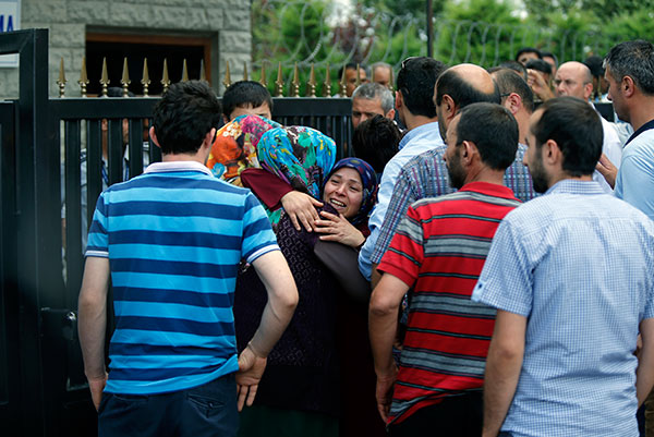 <div class='meta'><div class='origin-logo' data-origin='none'></div><span class='caption-text' data-credit='Emrah Gurel/AP Photo'>Family members of victims comfort each other outside the Forensic Medical Center in Istanbul, Wednesday, June 29, 2016.</span></div>