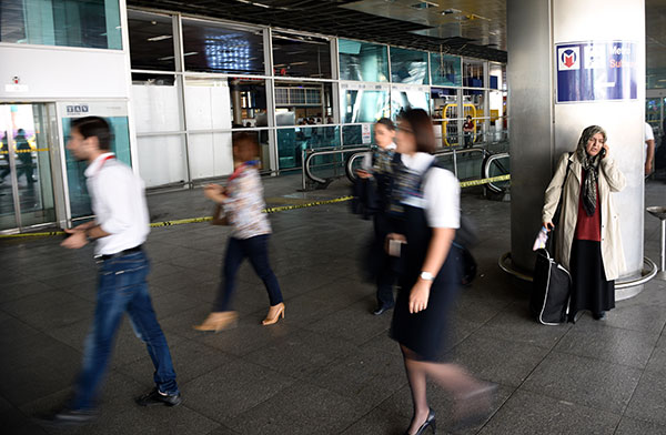 <div class='meta'><div class='origin-logo' data-origin='none'></div><span class='caption-text' data-credit='AP Photo'>Passengers arrive at an entrance of Ataturk Airport in Istanbul, Wednesday, June 29, 2016.</span></div>