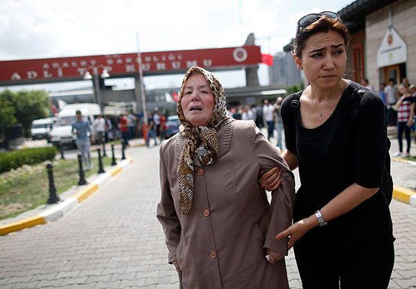 <div class='meta'><div class='origin-logo' data-origin='none'></div><span class='caption-text' data-credit='Emrah Gurel/AP Photo'>A family member helps Sacide Bugda, the mother of Abdulhakim Bugda, 24, one of victims, outside the Forensic Medical Center in Istanbul, Wednesday, June 29, 2016.</span></div>