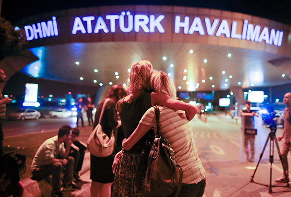 <div class='meta'><div class='origin-logo' data-origin='none'></div><span class='caption-text' data-credit='Emrah Gurel/AP Photo'>Passengers embrace each other at the entrance to Istanbul's Ataturk airport, early Wednesday, June 29, 2016 following their evacuation after a blast.</span></div>