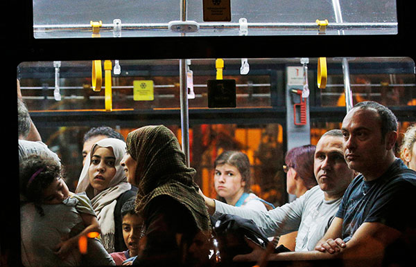 <div class='meta'><div class='origin-logo' data-origin='none'></div><span class='caption-text' data-credit='Emrah Gurel/AP Photo'>A flight's passengers leave on a bus from Istanbul's Ataturk airport, early Wednesday, June 29, 2016 following their evacuation after a blast.</span></div>