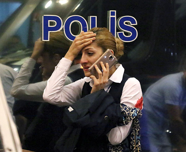 <div class='meta'><div class='origin-logo' data-origin='none'></div><span class='caption-text' data-credit='DHA via AP'>A woman reacts outside Istanbul's Ataturk airport, Tuesday, June 28, 2016.</span></div>