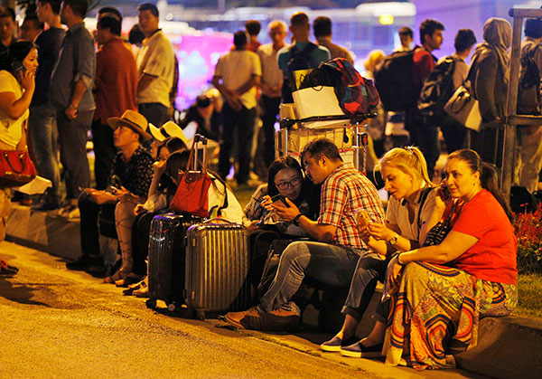 <div class='meta'><div class='origin-logo' data-origin='none'></div><span class='caption-text' data-credit='Emrah Gurel/AP Photo'>People gather outside Istanbul's Ataturk airport, early Wednesday, June 29, 2016 following its evacuation after a blast.</span></div>