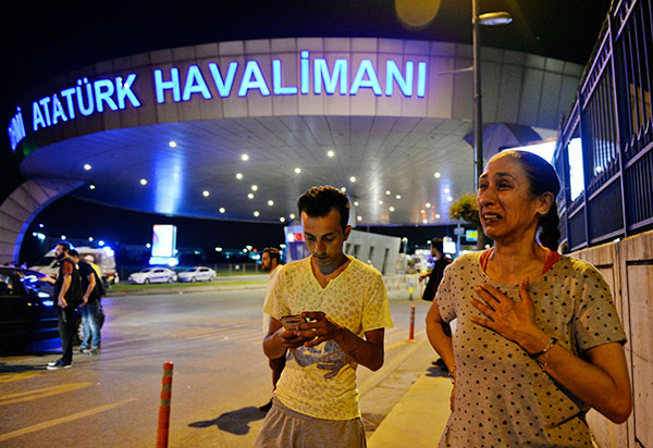 <div class='meta'><div class='origin-logo' data-origin='none'></div><span class='caption-text' data-credit='Emrah Gurel/AP Photo'>People gather on the entrance to Istanbul's Ataturk airport, early Wednesday, June 29, 2016.</span></div>