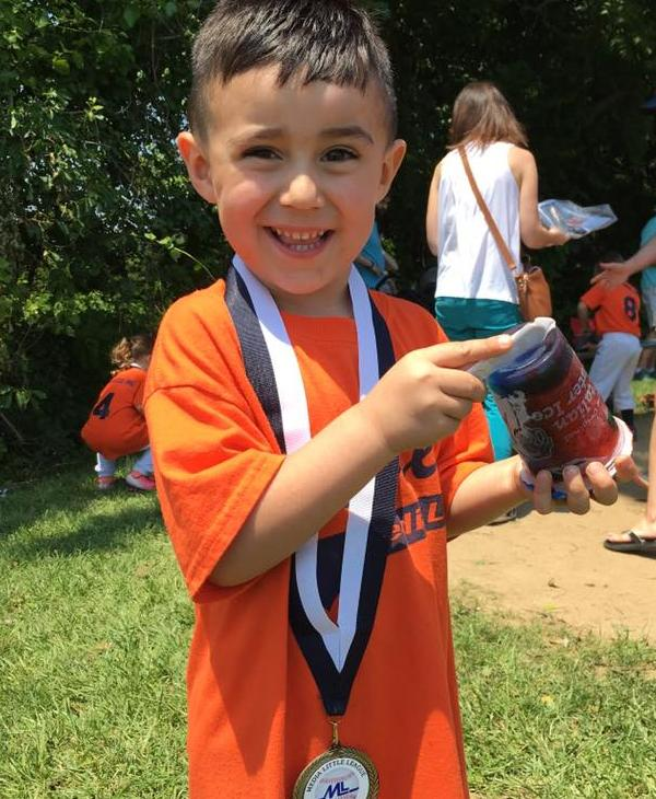 <div class='meta'><div class='origin-logo' data-origin='none'></div><span class='caption-text' data-credit=''>Dante Angelo Rivera with his medal after finishing up his first year with Media Little League</span></div>