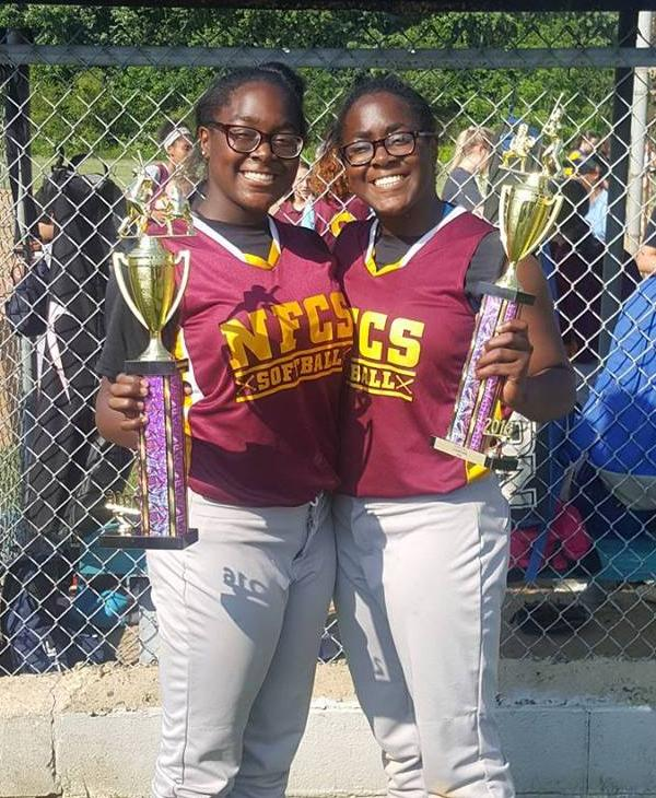 <div class='meta'><div class='origin-logo' data-origin='none'></div><span class='caption-text' data-credit=''>Twins Brittani and Brianna with their first championship at New Foundation Charter School</span></div>