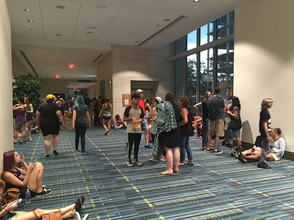 """<div class=""""meta image-caption""""><div class=""""origin-logo origin-image wtvd""""><span>WTVD</span></div><span class=""""caption-text"""">Fans at the Twenty One Pilots concert at the Red Hat Amphitheater in Raleigh wait out the storm Wednesday at the Convention Center. (Caroline F. Welch)</span></div>"""