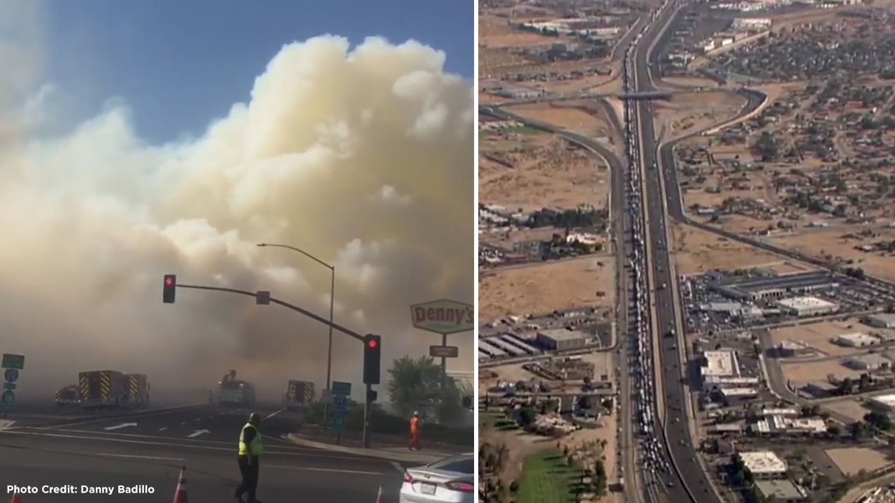 A brush fire along the 15 Freeway backed up traffic for miles in Victorville on Thursday, June 30, 2016.