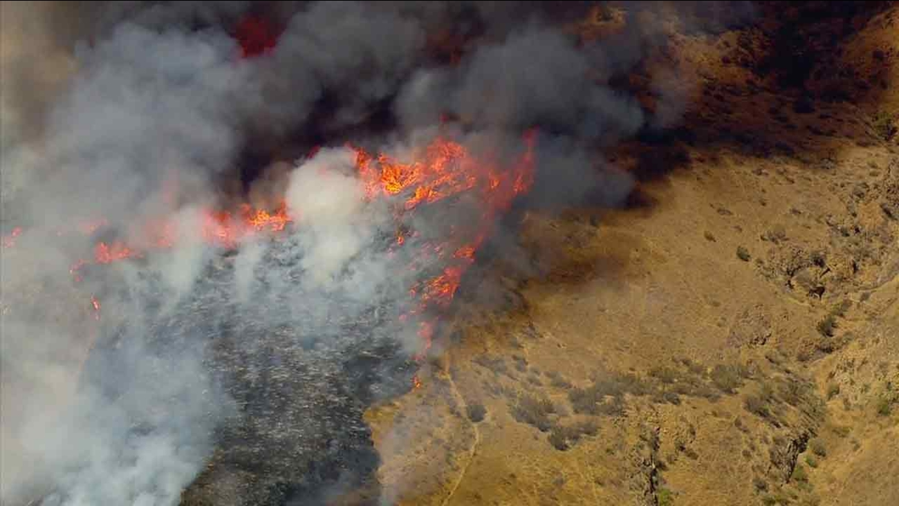 A brush fire is seen burning near Highway 118 in Simi Valley on Friday, July 1, 2016.