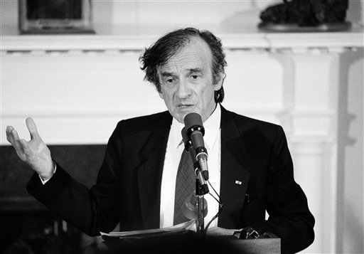 <div class='meta'><div class='origin-logo' data-origin='AP'></div><span class='caption-text' data-credit='AP'>Holocaust survivor Elie Wiesel gestures while talking on April 20, 1985 during a White House in Washington.</span></div>