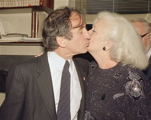 <div class='meta'><div class='origin-logo' data-origin='AP'></div><span class='caption-text' data-credit='Richard Drew'>Author and death camp survivor Elie Wiesel kisses his wife Marion as they greet the press in their apartment in New York, Oct. 14, 1986.</span></div>