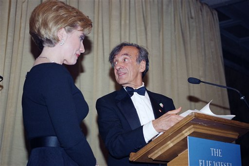<div class='meta'><div class='origin-logo' data-origin='AP'></div><span class='caption-text' data-credit='(AP Photo/Kevin Larkin)'>Hillary Rodham Clinton, left and Elie Wiesel stand at the podium as she accepts the Humanitarian Award from the Elie Wiesel Foundation in 1994.</span></div>