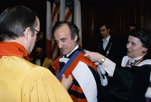 <div class='meta'><div class='origin-logo' data-origin='AP'></div><span class='caption-text' data-credit='AP'>1986 Nobel Peace Prize winning writer Elie Wiesel, is awarded the rank of Doctor Honoris Causa</span></div>