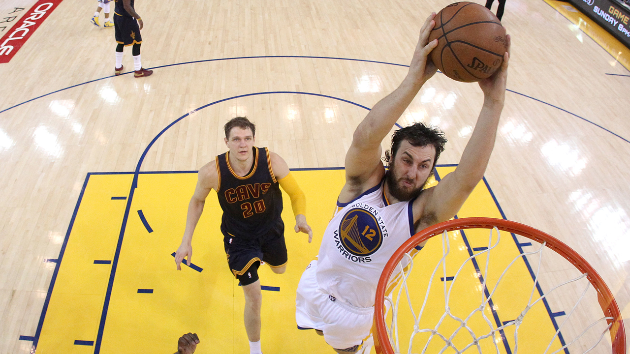 FILE -- Warriors center Andrew Bogut (12) dunks against Cavaliers center Timofey Mozgov (20) during the second half of Game 1 of basketball's NBA Finals in Oakland,  June 4. 2015.