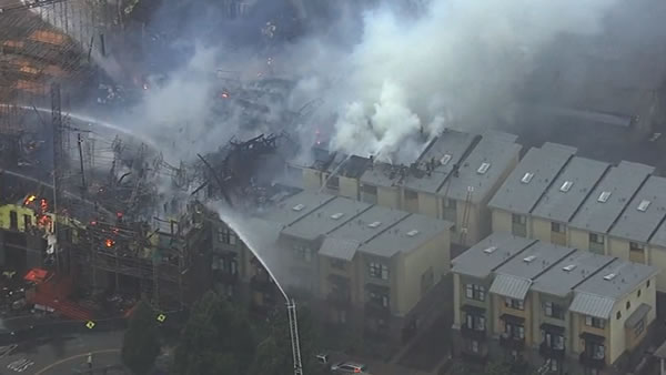 "<div class=""meta image-caption""><div class=""origin-logo origin-image none""><span>none</span></div><span class=""caption-text"">The 6-alarm fire burning in Emeryville, Calif. spreads to nearby townhomes on Wednesday, July 6, 2016. (KGO-TV)</span></div>"