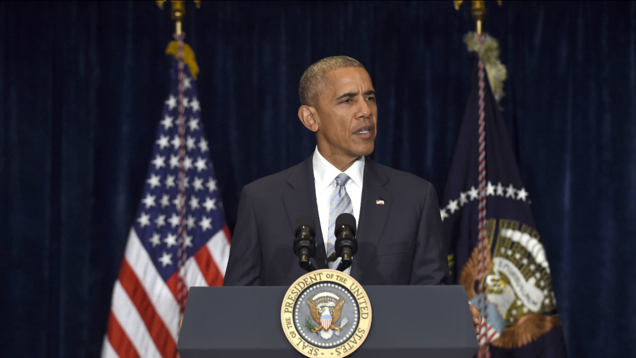 President Barack Obama makes a statement on the fatal police shootings of two black men in Louisiana and Minnesota after arriving in Warsaw, Poland, Friday, July 8, 2016.