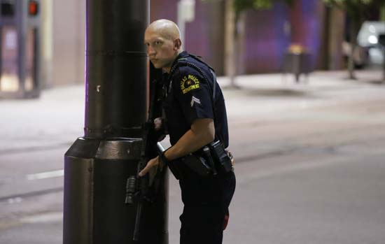 <div class='meta'><div class='origin-logo' data-origin='AP'></div><span class='caption-text' data-credit='AP Photo/LM Otero'>A Dallas policeman keeps watch on a street in downtown Dallas on July 7, 2016</span></div>