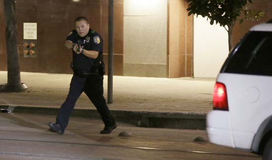 <div class='meta'><div class='origin-logo' data-origin='none'></div><span class='caption-text' data-credit='AP Photo/LM Otero'>Dallas police move to detains a driver after several police officers were shot in downtown Dallas</span></div>