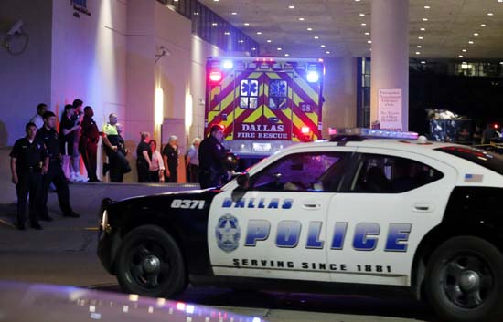 <div class='meta'><div class='origin-logo' data-origin='AP'></div><span class='caption-text' data-credit='AP Photo/Tony Gutierrez'>A Dallas police vehicle follows behind an ambulance carrying a patient to the emergency department at Baylor University Medical Center</span></div>