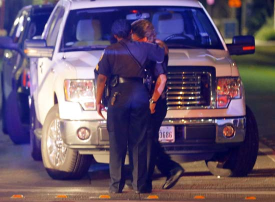 <div class='meta'><div class='origin-logo' data-origin='AP'></div><span class='caption-text' data-credit='AP Photo/Tony Gutierrez'>Two law enforcement officers console each other outside the emergency room of Baylor University Medical Center</span></div>