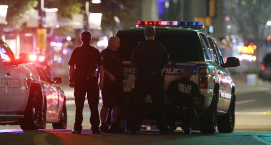 <div class='meta'><div class='origin-logo' data-origin='AP'></div><span class='caption-text' data-credit='AP Photo/LM Otero'>Police take cover behind a vehicle outside a parking garage in downtown Dallas</span></div>