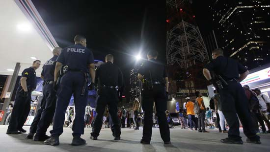 <div class='meta'><div class='origin-logo' data-origin='AP'></div><span class='caption-text' data-credit='AP Photo/LM Otero'>Dallas police gather as a crowd forms in downtown</span></div>