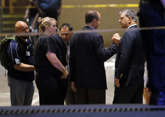 <div class='meta'><div class='origin-logo' data-origin='AP'></div><span class='caption-text' data-credit='AP Photo/Tony Gutierrez'>Dallas Mayor Mike Rawlings, right, talks with unknown persons as he arrives at the emergency room at Baylor University Medical Center</span></div>