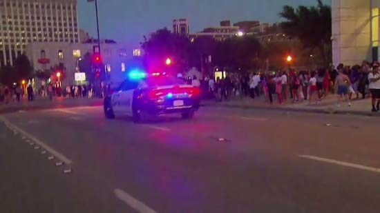 <div class='meta'><div class='origin-logo' data-origin='KTRK'></div><span class='caption-text' data-credit='CNN'>Images from Dallas following a deadly officer shooting in downtown</span></div>