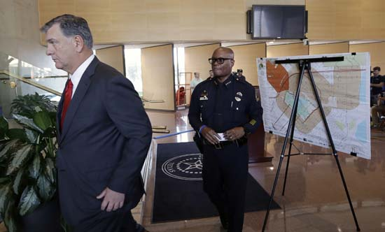 <div class='meta'><div class='origin-logo' data-origin='AP'></div><span class='caption-text' data-credit='AP Photo/Eric Gay'>Dallas mayor Mike Rawlings, left, and Dallas police chief David Brown, right, leave a news conference</span></div>