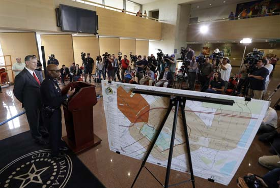 <div class='meta'><div class='origin-logo' data-origin='AP'></div><span class='caption-text' data-credit='AP Photo/Eric Gay'>Dallas mayor Mike Rawlings, at podium left, and Dallas police chief David Brown</span></div>