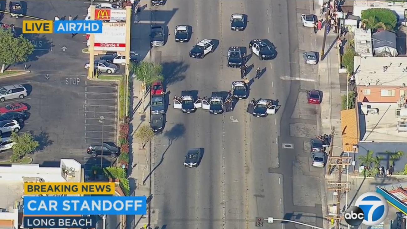 Long Beach police are in a standoff with a suspect in a black Mercedes.
