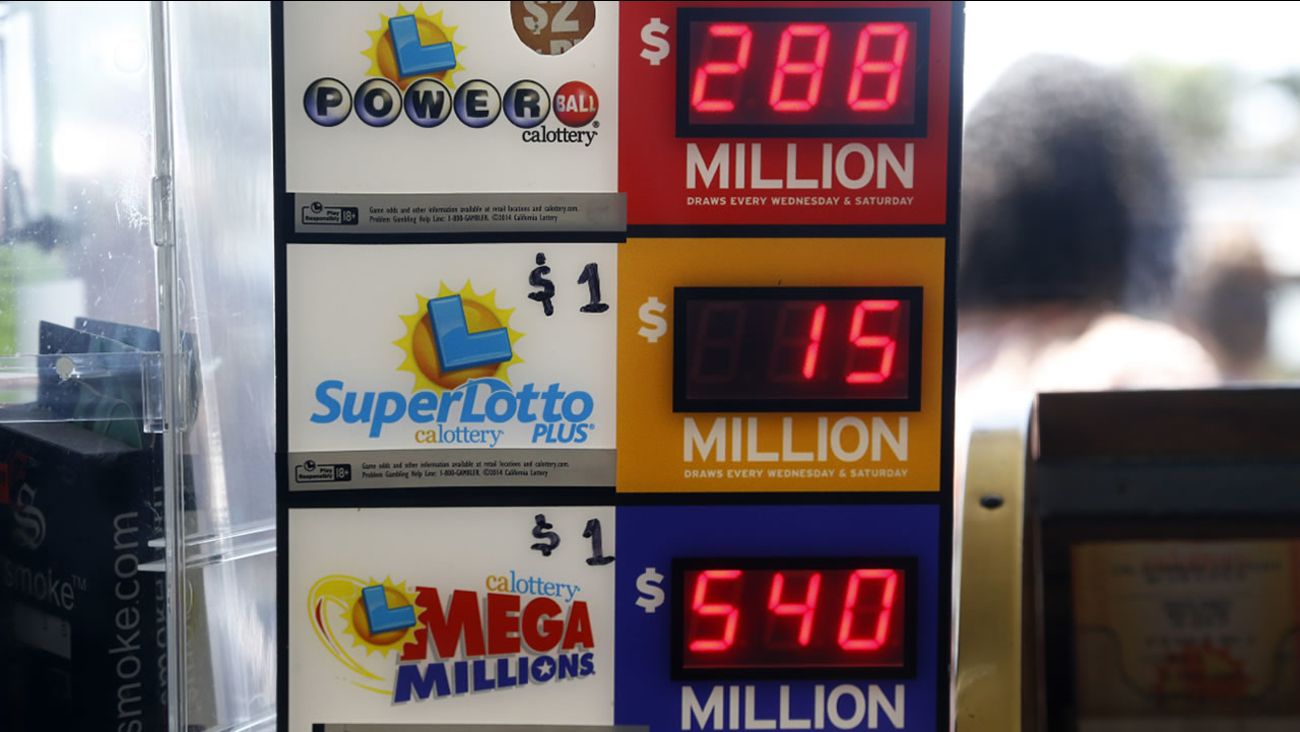 An electronic sign at Bluebird Liquors in Hawthorne, Calif., displays lottery jackpots Friday, July 8, 2016. The Mega Millions jackpot for Friday's drawing has soared to over $500 million.