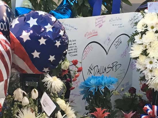 "<div class=""meta image-caption""><div class=""origin-logo origin-image ap""><span>AP</span></div><span class=""caption-text"">The memorial for the fallen Dallas officers is growing outside police headquarters. (KTRK)</span></div>"
