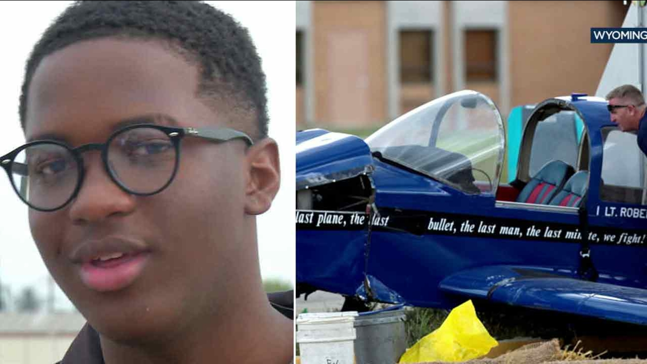 A man is seen moving Isaiah Cooper's (left) plane that crash-landed in Wyoming on Saturday, July 9, 2016.