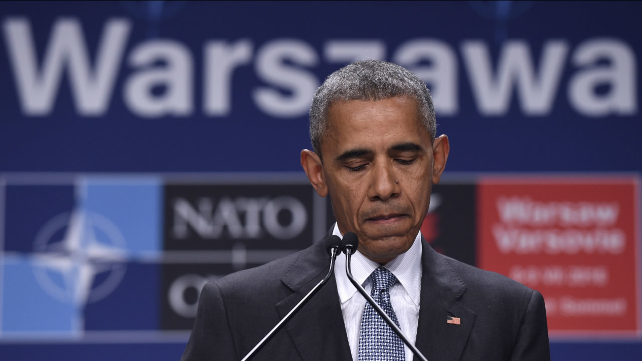 President Barack Obama pauses while speaking about the events in Dallas at the beginning of his news conference at PGE National Stadium in Warsaw, Poland, Saturday, July 9, 2016.