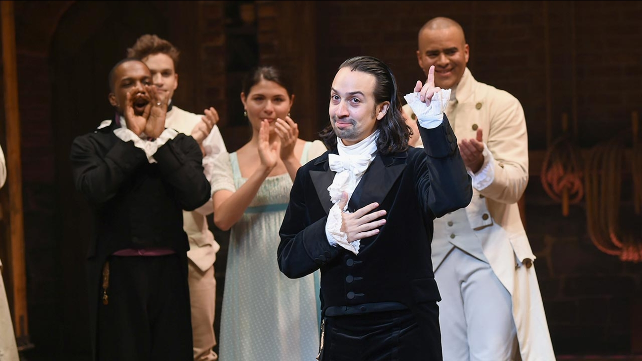 """Actors Leslie Odom Jr., left, Phillipa Soo, and Christopher Jackson take a bow with actor and """"Hamilton"""" creator Lin-Manuel Miranda during his final performance curtain call at the Richard Rogers Theatre on Saturday, July 9, 2016, in New York."""