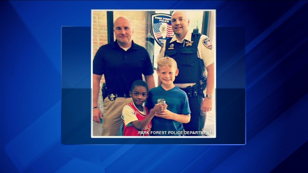 Blake Denman, 9, and C.J. McKinney, 8, stopped by the Park Forest Police Department with a jar full of change for Officer Tim Jones.
