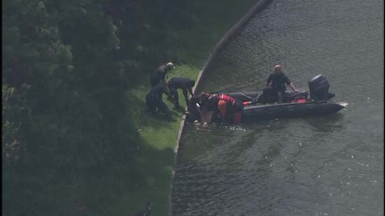 <div class='meta'><div class='origin-logo' data-origin='KTRK'></div><span class='caption-text' data-credit='KTRK'>Images of a naked man being pulled from the lake at Hermann Park</span></div>
