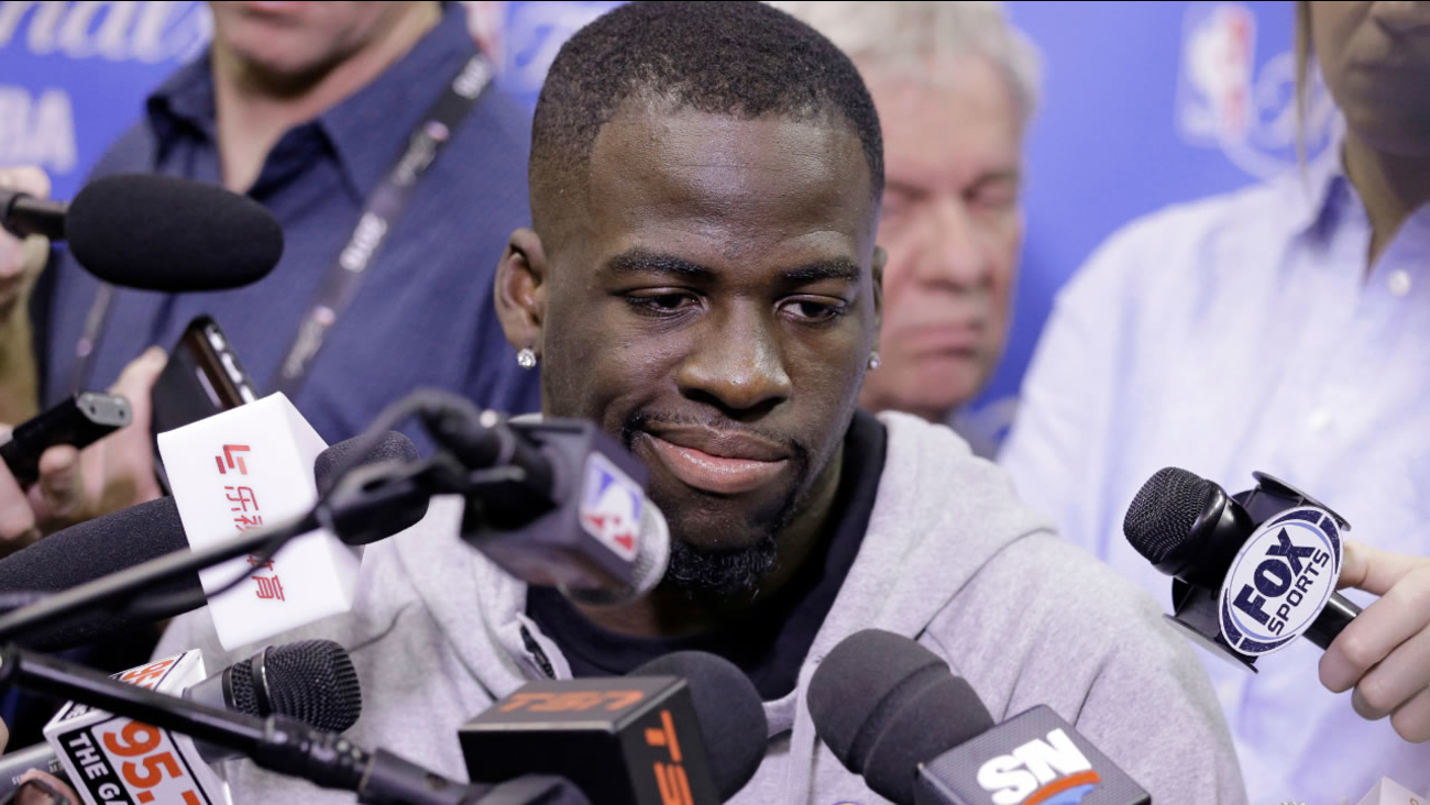 Golden State Warriors' Draymond Green answers questions before practice for Game 6 of the NBA basketball Finals, Wednesday, June 15, 2016, in Cleveland.  (AP Photo/Tony Dejak)