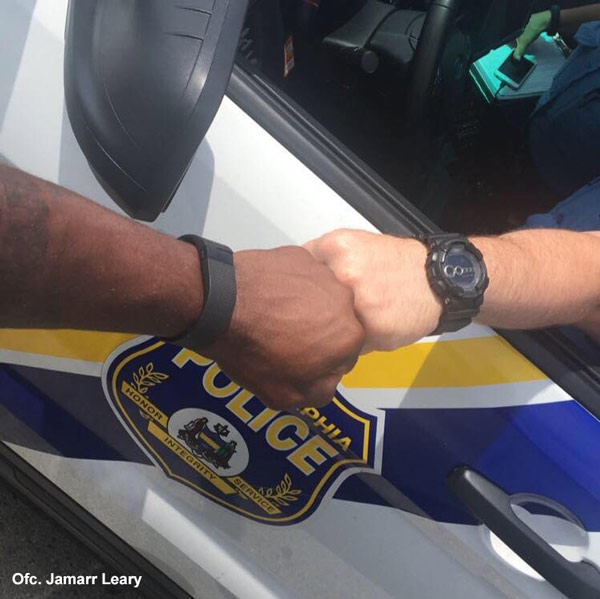 """<div class=""""meta image-caption""""><div class=""""origin-logo origin-image wpvi""""><span>WPVI</span></div><span class=""""caption-text"""">This picture was taken by Philadelphia Police Officer Jamaar Leary. Officers Leary and Officer Fitzpatrick """"felt the picture was appropriate"""" in the wake of recent events.</span></div>"""