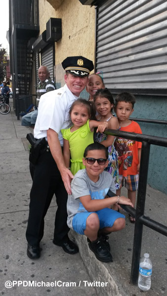 """<div class=""""meta image-caption""""><div class=""""origin-logo origin-image wpvi""""><span>WPVI</span></div><span class=""""caption-text"""">While protecting protesters, Philadelphia Police Captain Michael Cram of the 25th district spotted a few of the neighborhood kids who invited him to an upcoming block party.</span></div>"""