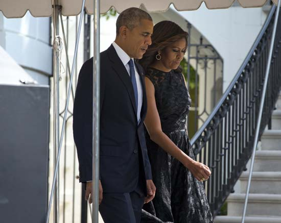 "<div class=""meta image-caption""><div class=""origin-logo origin-image ap""><span>AP</span></div><span class=""caption-text"">President Barack Obama and first lady Michelle Obama walk out of the White House in Washington (AP Photo/Pablo Martinez Monsivais)</span></div>"