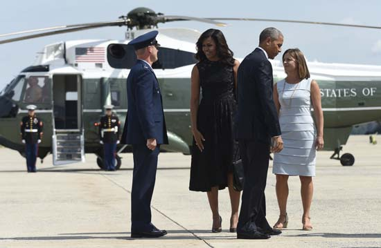 "<div class=""meta image-caption""><div class=""origin-logo origin-image ap""><span>AP</span></div><span class=""caption-text"">President Barack Obama and first lady Michelle Obama prepare to walk up the steps of Air Force One at Andrews Air Force Base in Md. (AP Photo/Susan Walsh)</span></div>"