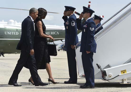 "<div class=""meta image-caption""><div class=""origin-logo origin-image ap""><span>AP</span></div><span class=""caption-text"">President Barack Obama and first lady Michelle Obama walk up the steps of Air Force One at Andrews Air Force Base (AP Photo/Susan Walsh)</span></div>"
