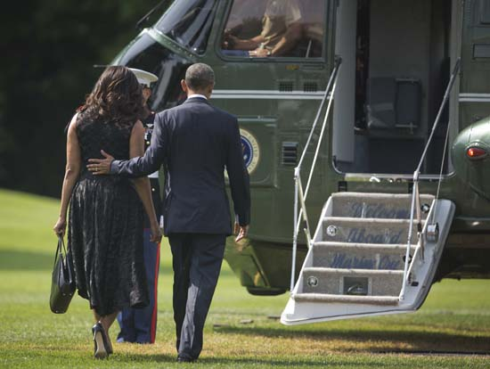 "<div class=""meta image-caption""><div class=""origin-logo origin-image ap""><span>AP</span></div><span class=""caption-text"">President Barack Obama and first lady Michelle Obama walk across the South Lawn of the White House in Washington (AP Photo/Pablo Martinez Monsivais)</span></div>"