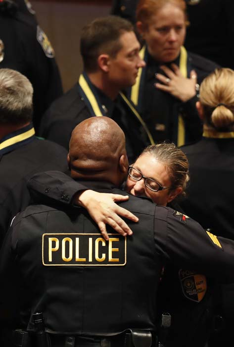 <div class='meta'><div class='origin-logo' data-origin='AP'></div><span class='caption-text' data-credit='AP Photo/Eric Gay'>DART police officer Misty McBride, right, is embrace by a fellow officer as she arrive for a memorial</span></div>